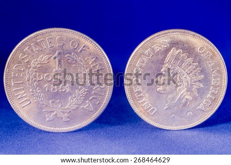 One dollar silver coin front and reverse with Indian profile on the reverse - stock photo