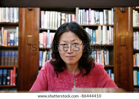 One East Asian woman study in the local library