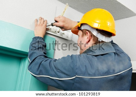 One electrician at work installing and assembling electric lamp holder - stock photo