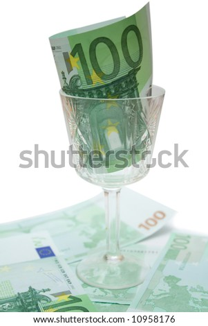 one 100 eur banknote in wineglass over white isolated background - stock photo