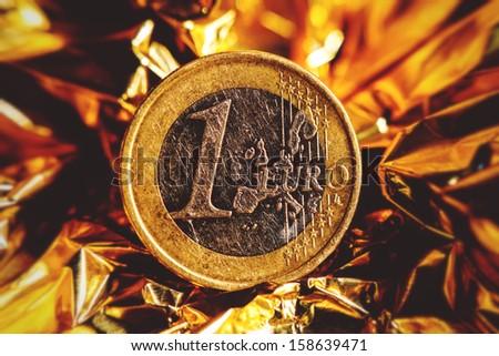 One euro coin on black background. Contour light.  - stock photo