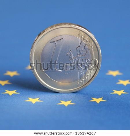 One Euro coin on the EU flag - stock photo