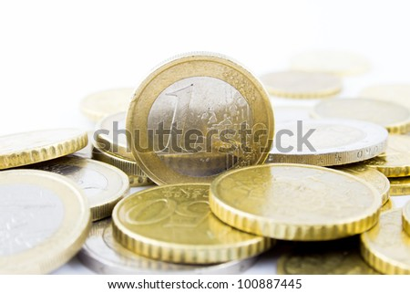 One euro on a stack of euros - stock photo