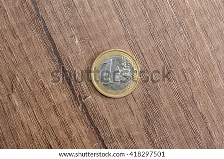 one euro on desk - stock photo