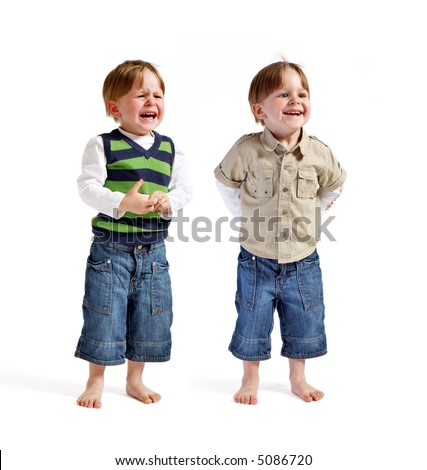 One face two emotions. Two very cute twin boys (smiling & crying) isolated on white background. - stock photo