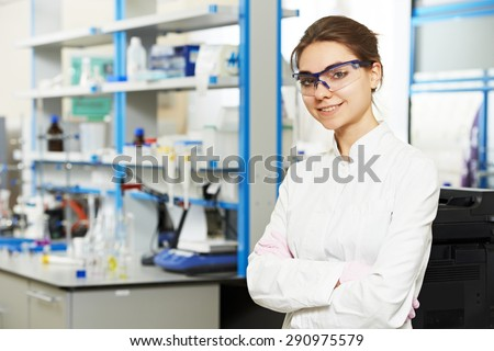 One female scientist researcher making research in chemistry laboratory - stock photo