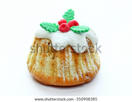 One festive Christmas cupcakes with traditional decoration isolated on white background - stock photo