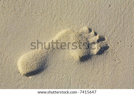 One footprint on the sandy coral beach