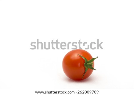 One fresh cherry tomato isolated on white background. - stock photo