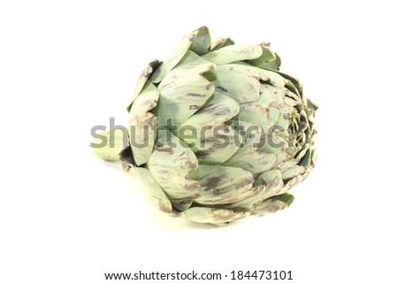 one fresh green Artichoke on a light background - stock photo