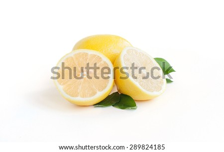 One full lemon and two parts on the white - stock photo