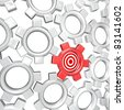 One gear in a mechanism of turning gears, symbolizing workers or teammates in an organization, is singled out and targeted as the most important player in the team - stock photo
