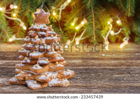 one gingerbread  tree with christmas lights in background - stock photo