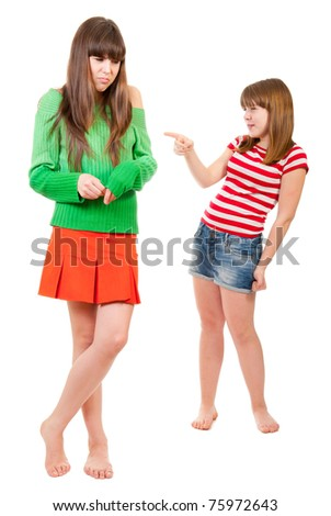 One girl is hurt, the other laughs and mocks her - stock photo