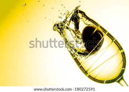 One glass, a lemon and some water splash