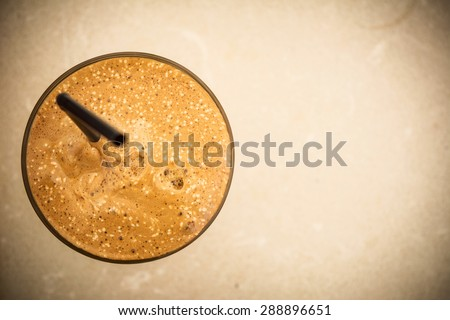 One glass of a Greek frappe from above with copy-space on the right side - stock photo