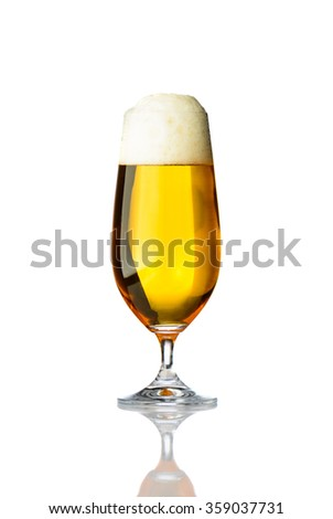 One glass of pilsner beer isolated on white background