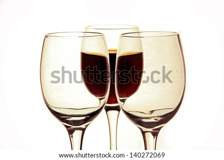 one glass of wine, two empty clear glass, white background.