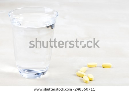 One glass Water and Pills