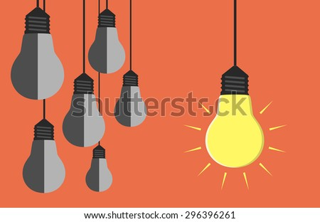 One glowing light bulb hanging beside many gray dull ones. Innovation, motivation, insight, inspiration concept - stock photo