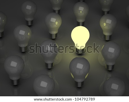 One glowing light bulb standing out from the unlit incandescent bulbs, the different concept - stock photo