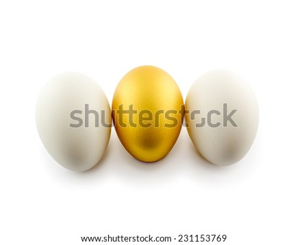 one golden egg with two white isolated on white background - stock photo