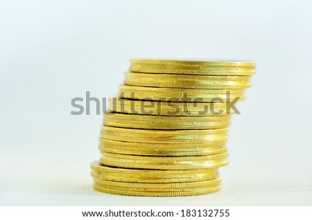 One Golden gold coins stack on a lean, isolated on white background. Concept photo of bank, money, banking, finance, economy,  saving and loans (Isolated on white background) - stock photo