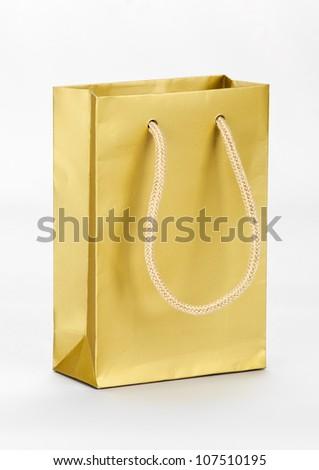 One golden shopping bag on white. - stock photo