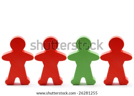One green and three orange wooden men in a row. - stock photo