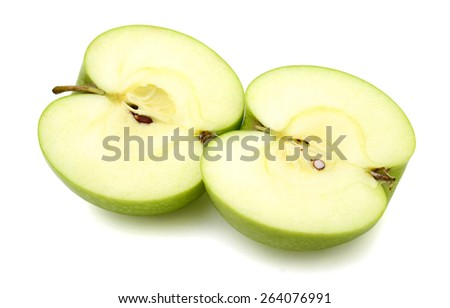 one green apple cut half isolated on white  - stock photo