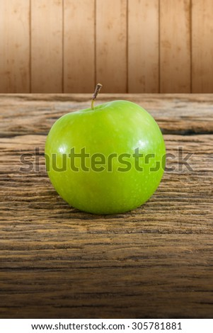 One Green apple on wooden table