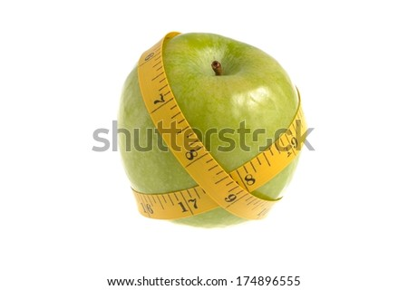 One green apple with measuring tape isolated on white background