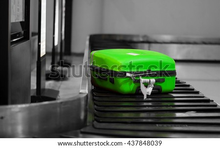 One green bagged on the conveyor in the air port. - stock photo