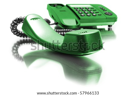 One green phone with mirror reflexion on white background - stock photo