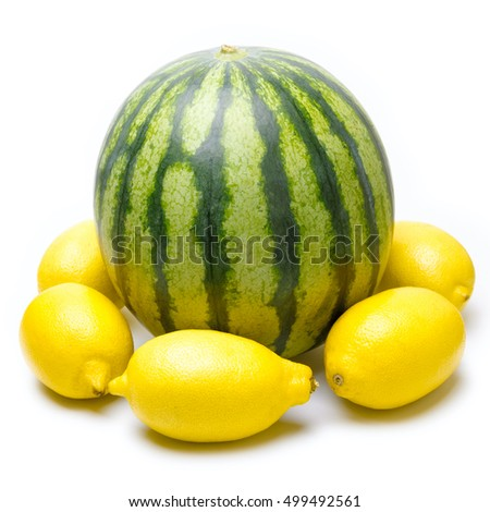 One green striped watermelon with lemons isolated on white background