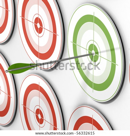 one green target and an arrow hitting the center and many red targets - stock photo
