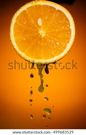 One half of orange isolated on colorful background