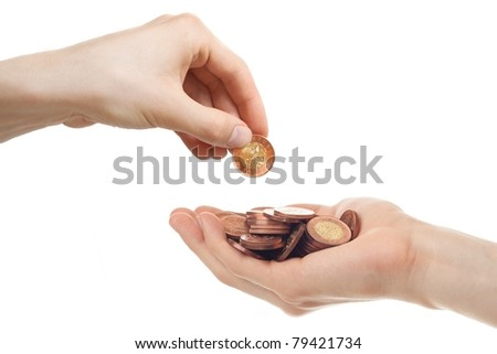One hand borrowing money from another. - stock photo