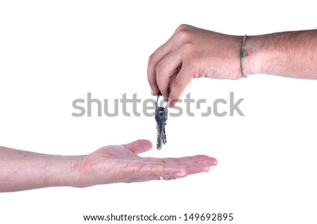 one hand giving keys to other isolated on white background - stock photo