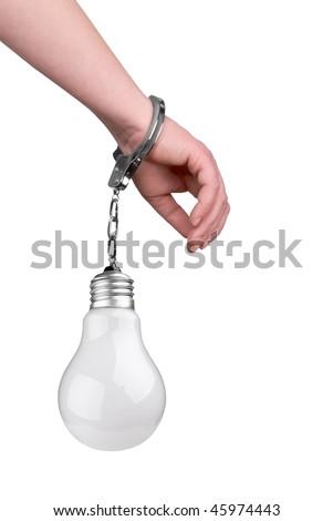 One hand handcuffed to a incandescent lightbulb isolated over white - stock photo