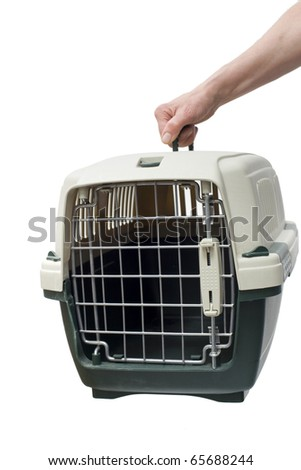 one hand holding a pet carrier - stock photo