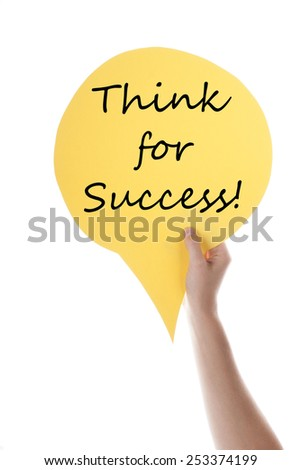 One Hand Holding A Yellow Speech Balloon Or Speech Bubble With English Life Quote Think For Success Isolated On White - stock photo