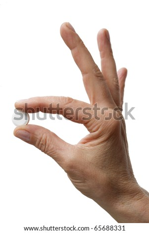 one hand holding one tablet - stock photo