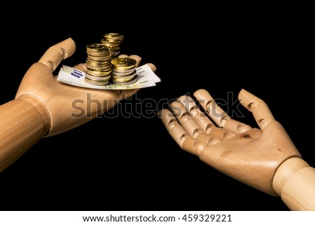 One hand holds money, another hand demand alms.  On black background. With copy space. - stock photo