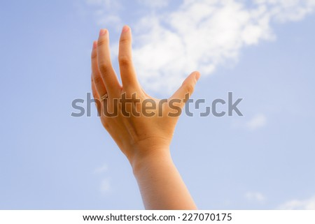 one hand lady on sky - stock photo