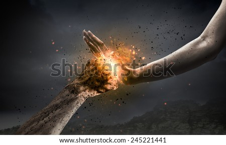 One hand preventing punch attack of another hand - stock photo