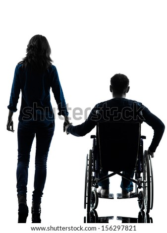 one handicapped man and woman holding hands in silhouette studio  on white background - stock photo