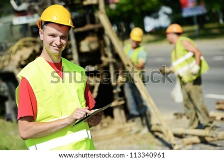 One happy smiling engineer site manager builder with tablet PC at geology roadwork construction site - stock photo