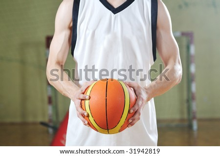 one healthy young  man play basketball game in school gym indoor - stock photo