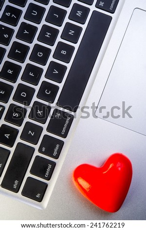 one heart valentine lies on the laptop